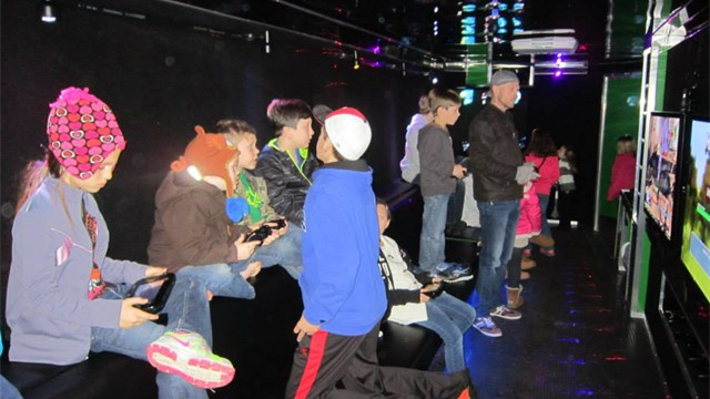 Combine Laser Tag and our Rockin' Rollin' Video Game Party Theater...